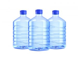 Three 5-gallon water jugs white blue caps on a white background.